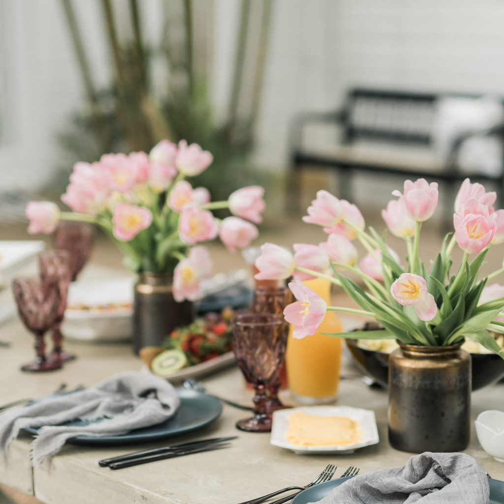 Oh Happy Day set table with neutrals, gray accents and light pink tulips