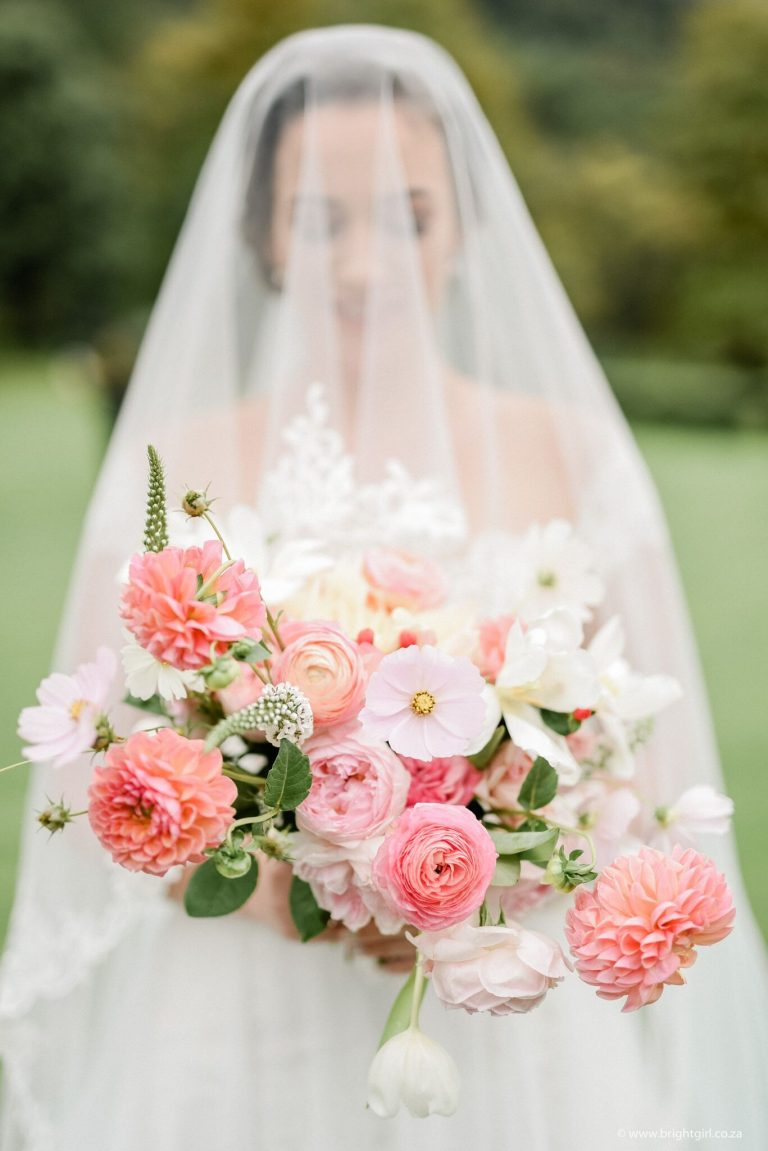 veiled-bride-with-blush-and-coral-bouquet