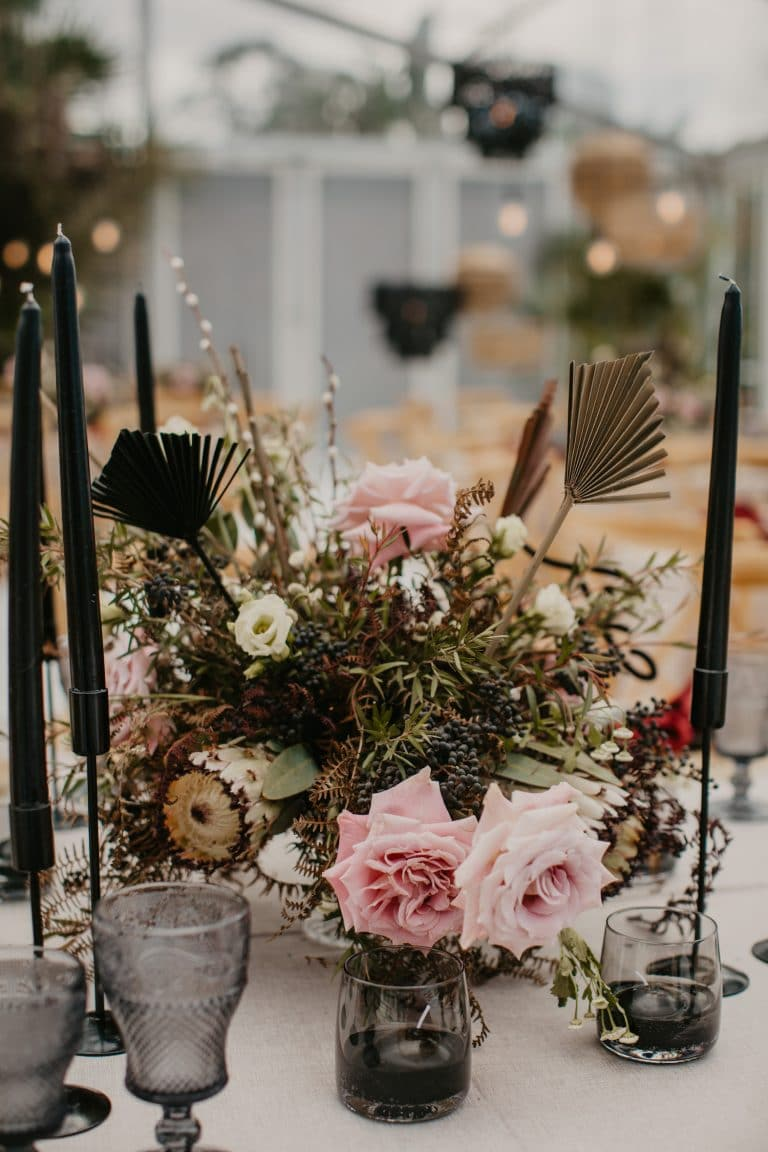 centerpiece-with-roses-and-tropical-foliage