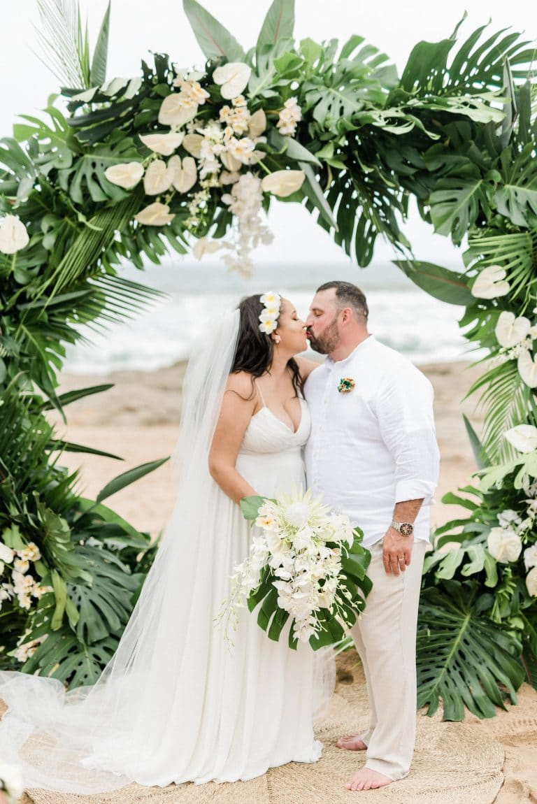 circular-wedding-arch-tropical-greenery-white-flowers