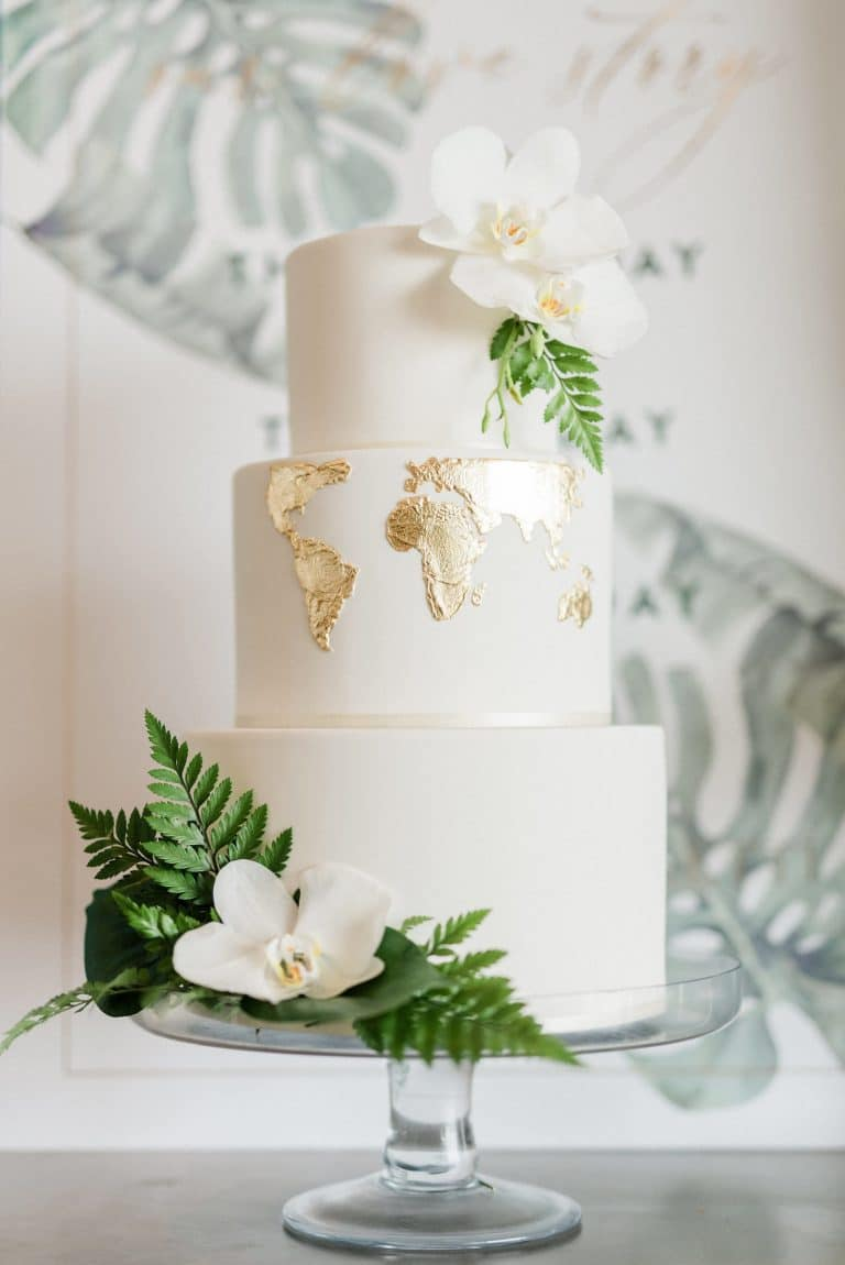 white-cake-with-gold-leaf-map
