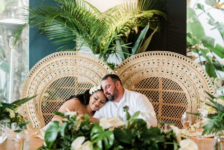 tropical-destination-wedding-bride-and-groom-peacock-chairs