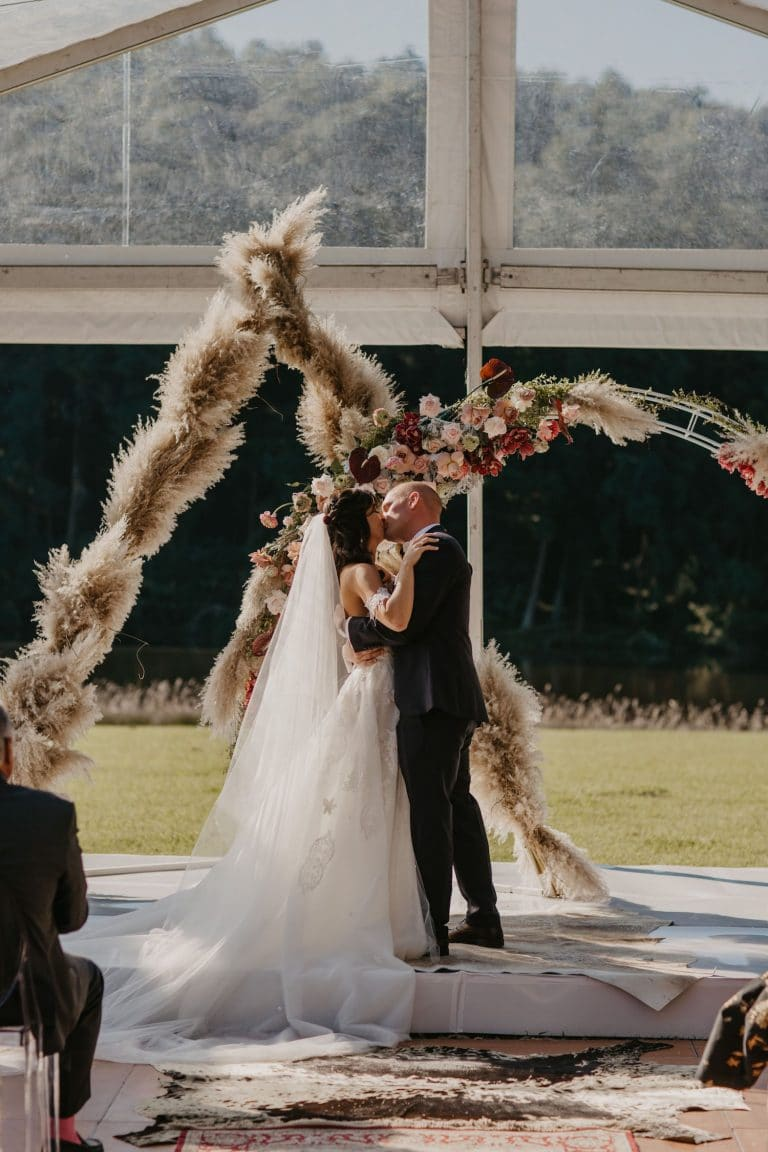 double-geometric-wedding-arch-with-florals-and-pampas-grass