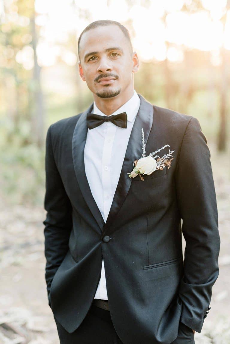 classic black tux groom