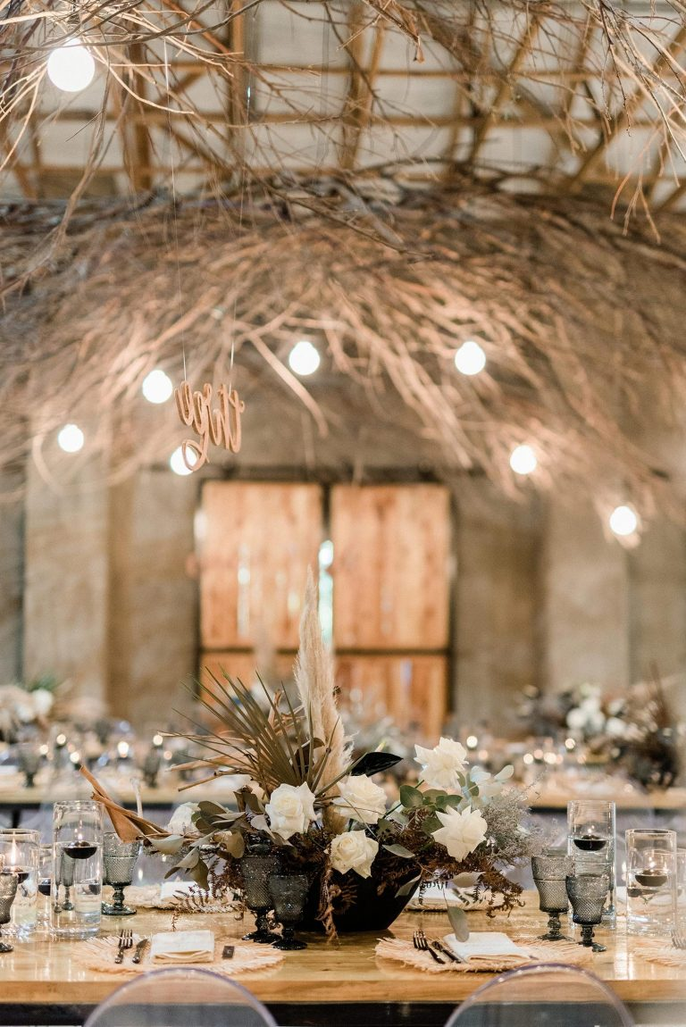 dried foliage and white flower centerpiece