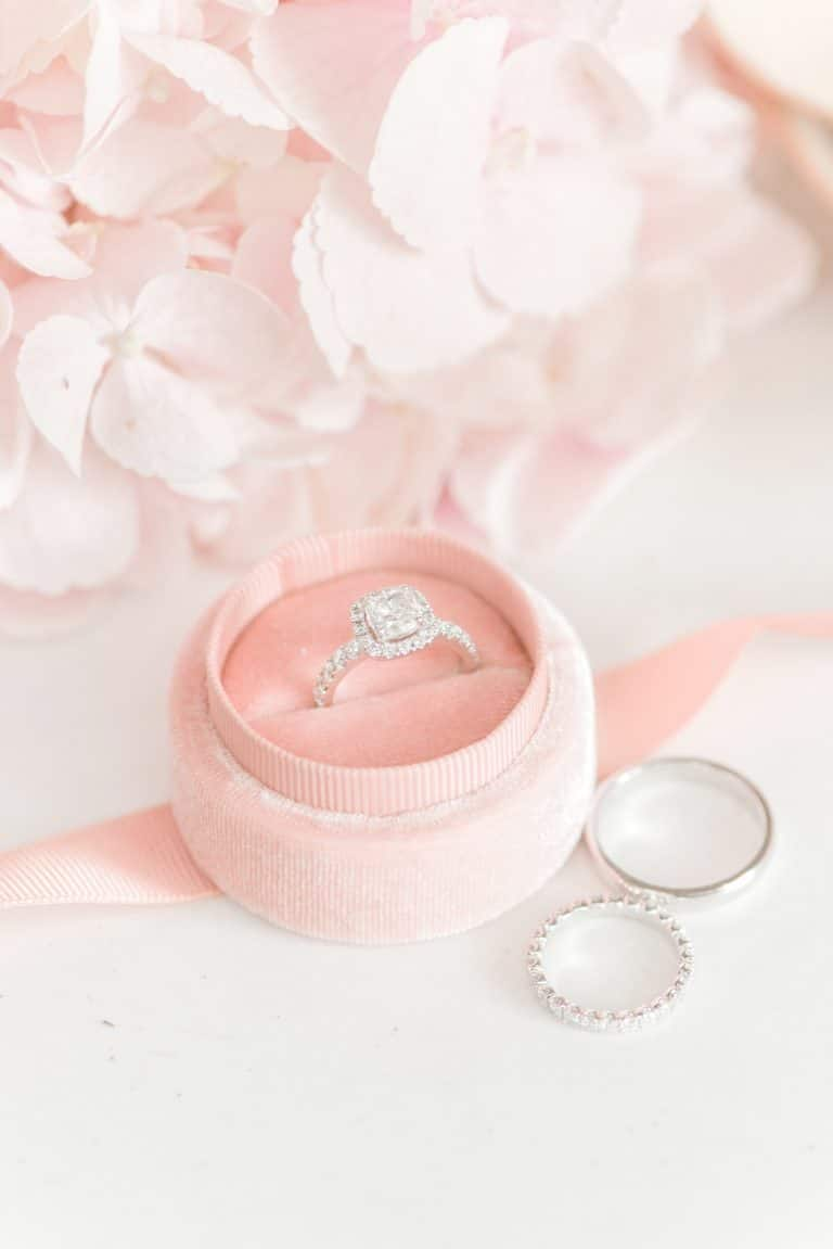 cushion cut halo engagement ring in pink velvet box