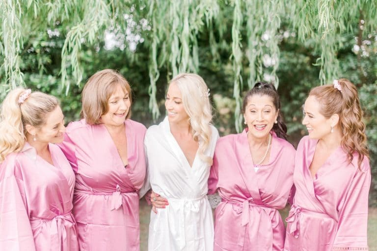 bridesmaids in pink robes