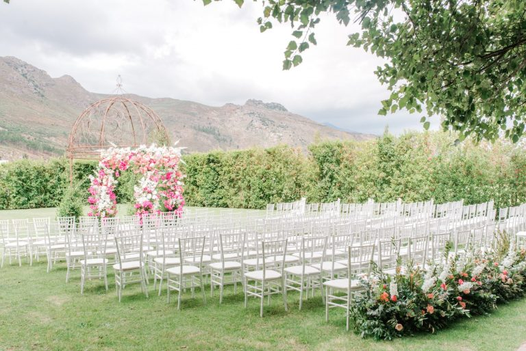 franschhoek outdoor wedding ceremony with floral arch