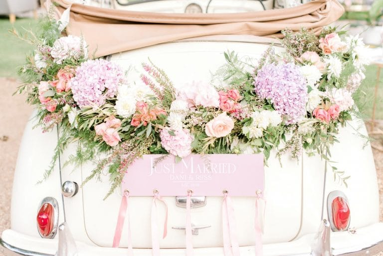 morris minor getaway car with flower decorations