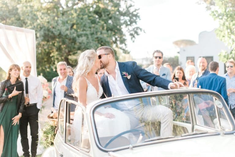 bride and groom with morris minor wedding car