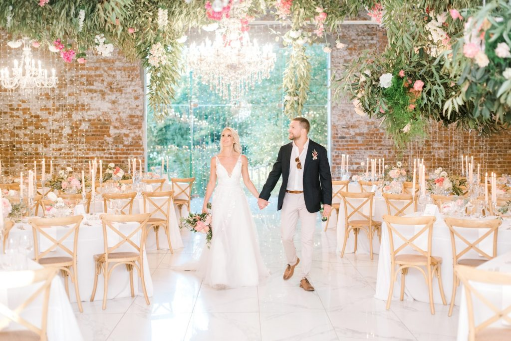 bride and room seeing reception room for first time