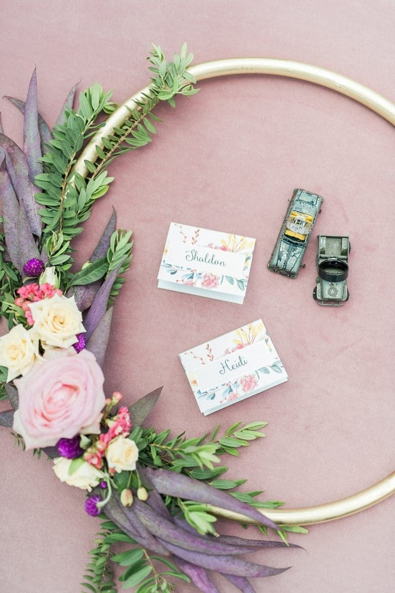bridal hoop bouquet with floral place cards and toy cars