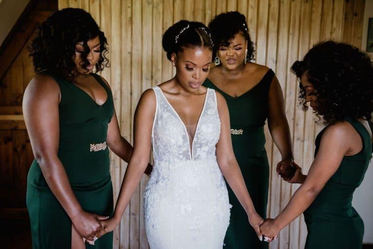 bride and bridesmaids prayer