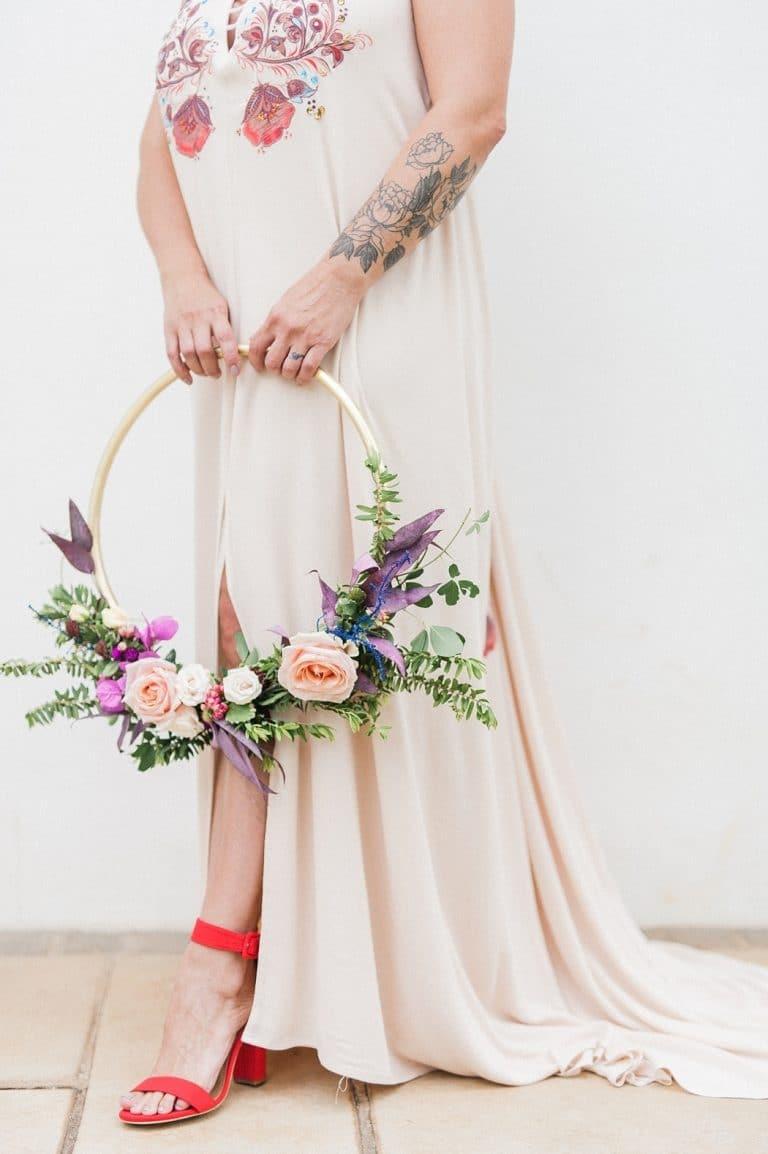 bride with hoop bouquet