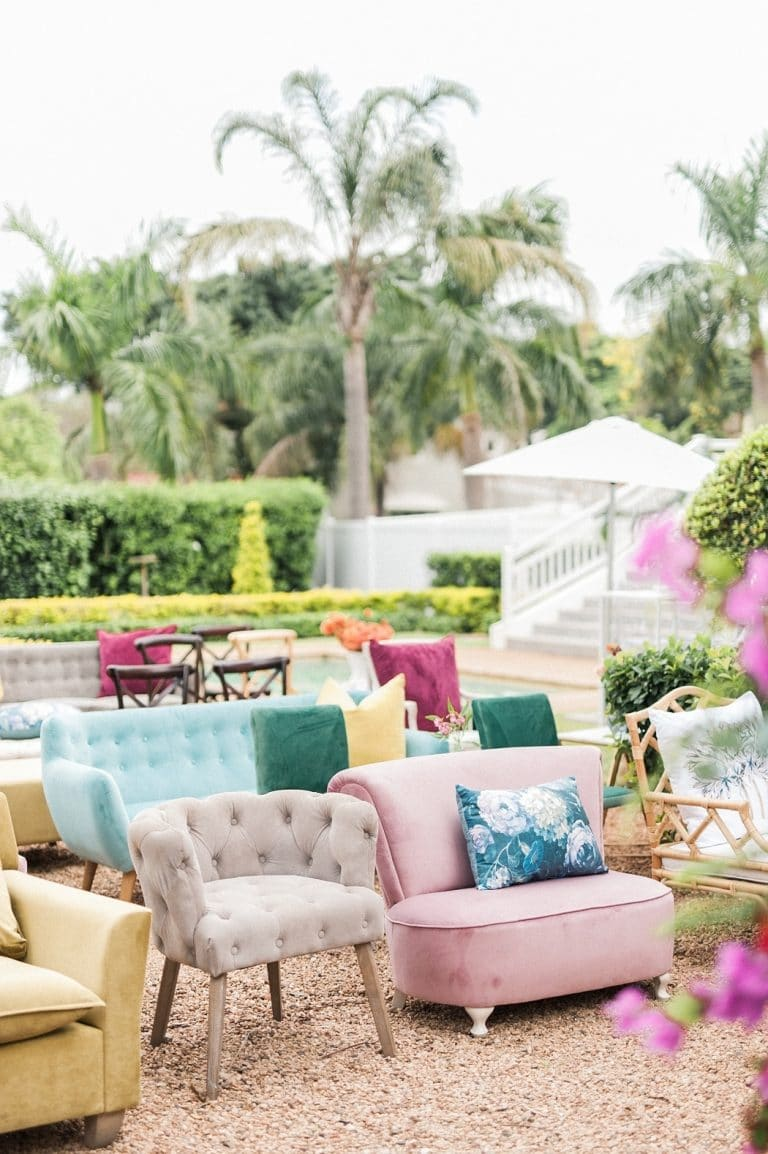 mismatched colourful seating for at-home wedding