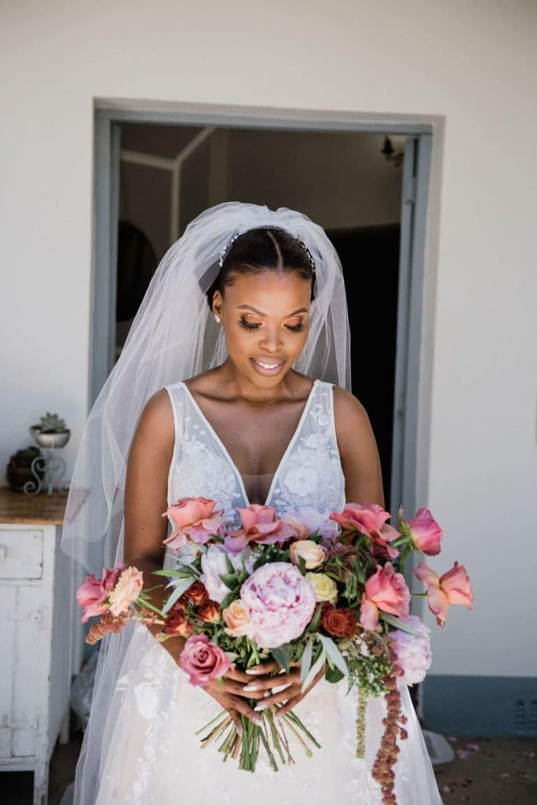 bride with rose and peony bouquet