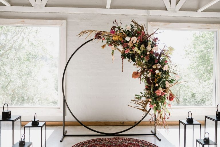 wedding ceremony circle arch with flowers