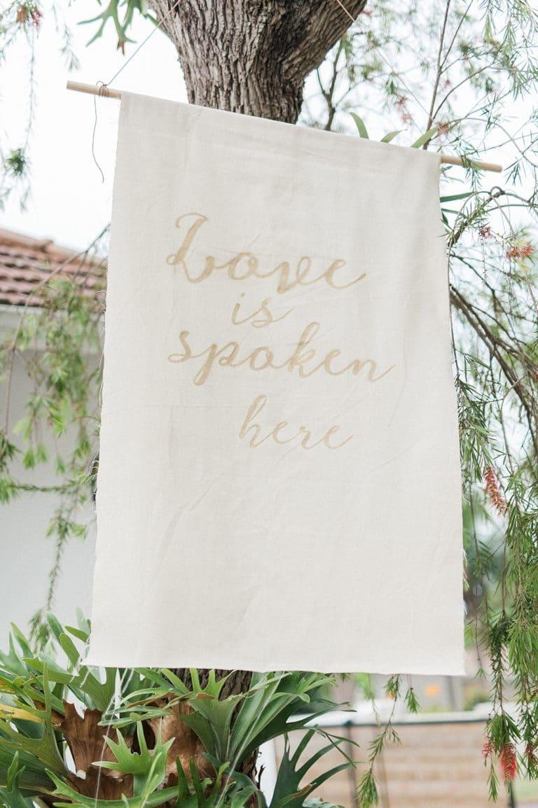 fabric banner love is spoken here