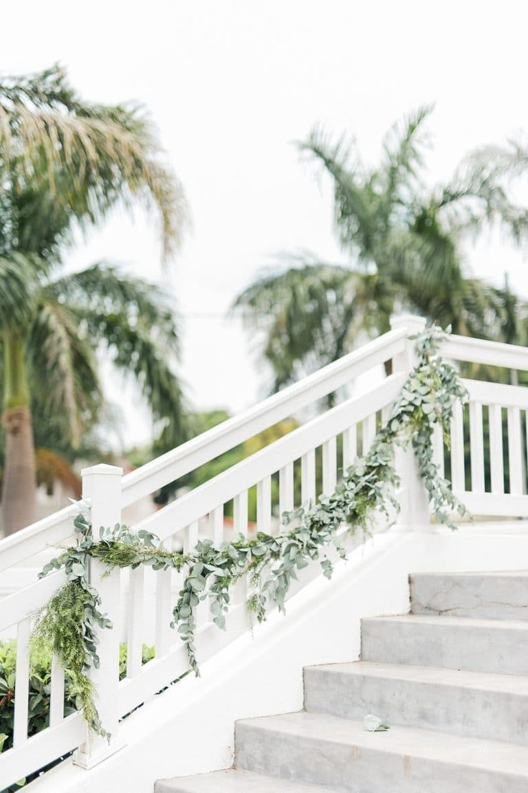 at-home wedding staircase greenery
