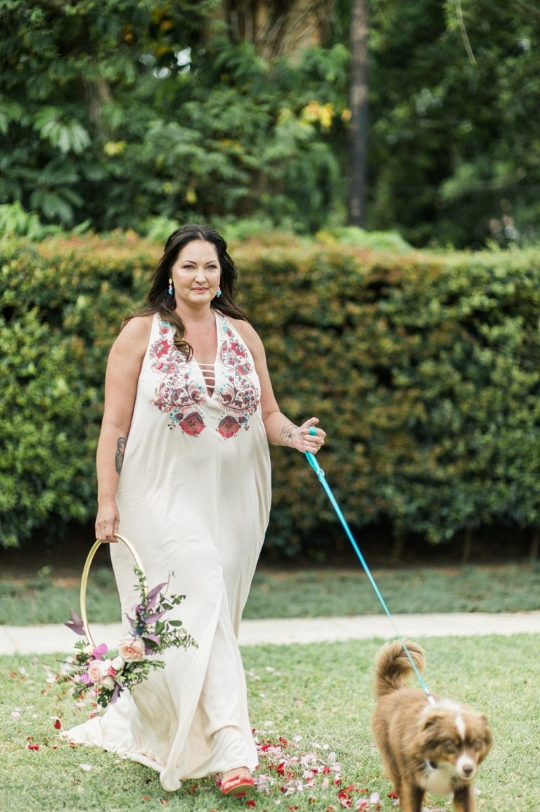bride with dog attendant