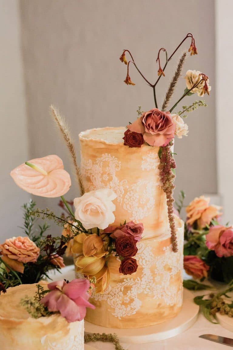 yellow wedding cakes with floral decoration