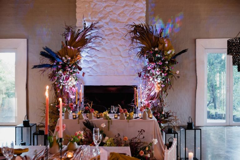 fireplace floral installation with neon lights
